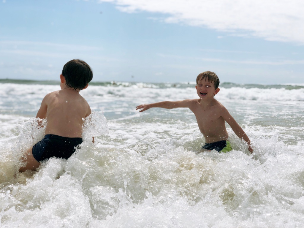 finding your flow at the beach / boy playing joyfully at the beach