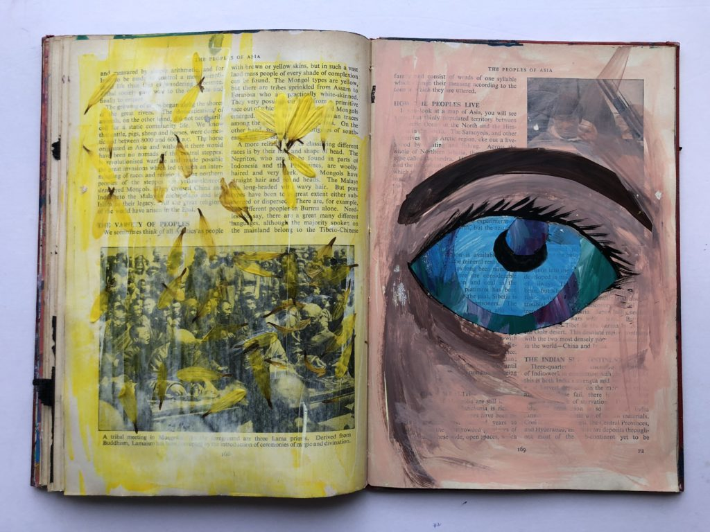1 of 4. Cut through art journaling page of an eye and flower petals.