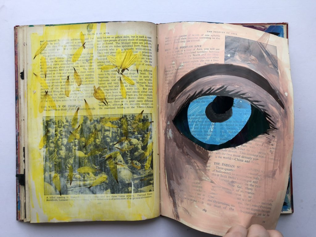2 of 4. Cut through art journaling page of an eye and flower petals.