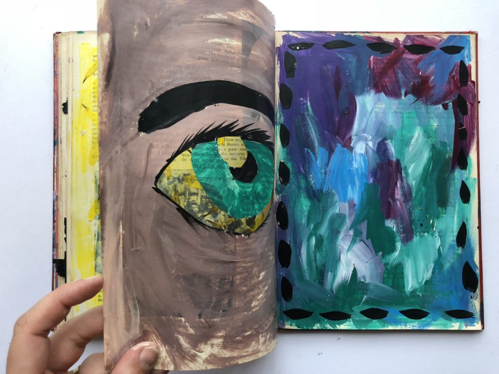 3 of 4. Cut through art journaling page of an eye and flower petals.