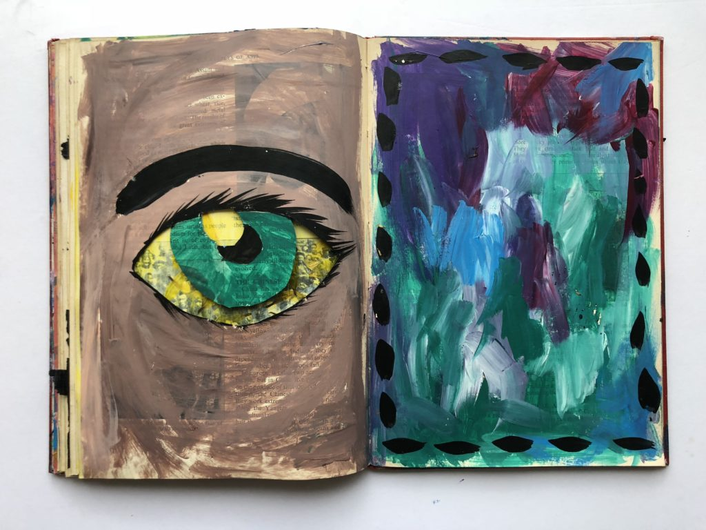 4 of 4. Cut through art journaling page of an eye and flower petals.